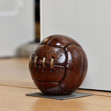 Antique Football Doorstop on Steel Base