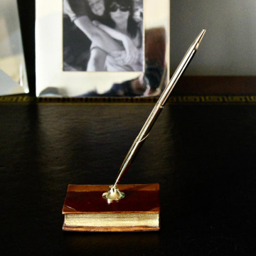 Gilt Pen & Holder on Book